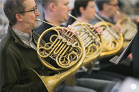 French horn players of the orchestra in rehearsal