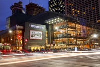 Photo of the exterior of the Four Seasons Centre theatre at night