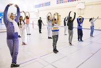 Photo of children in a movement workshop in a school gymnasium
